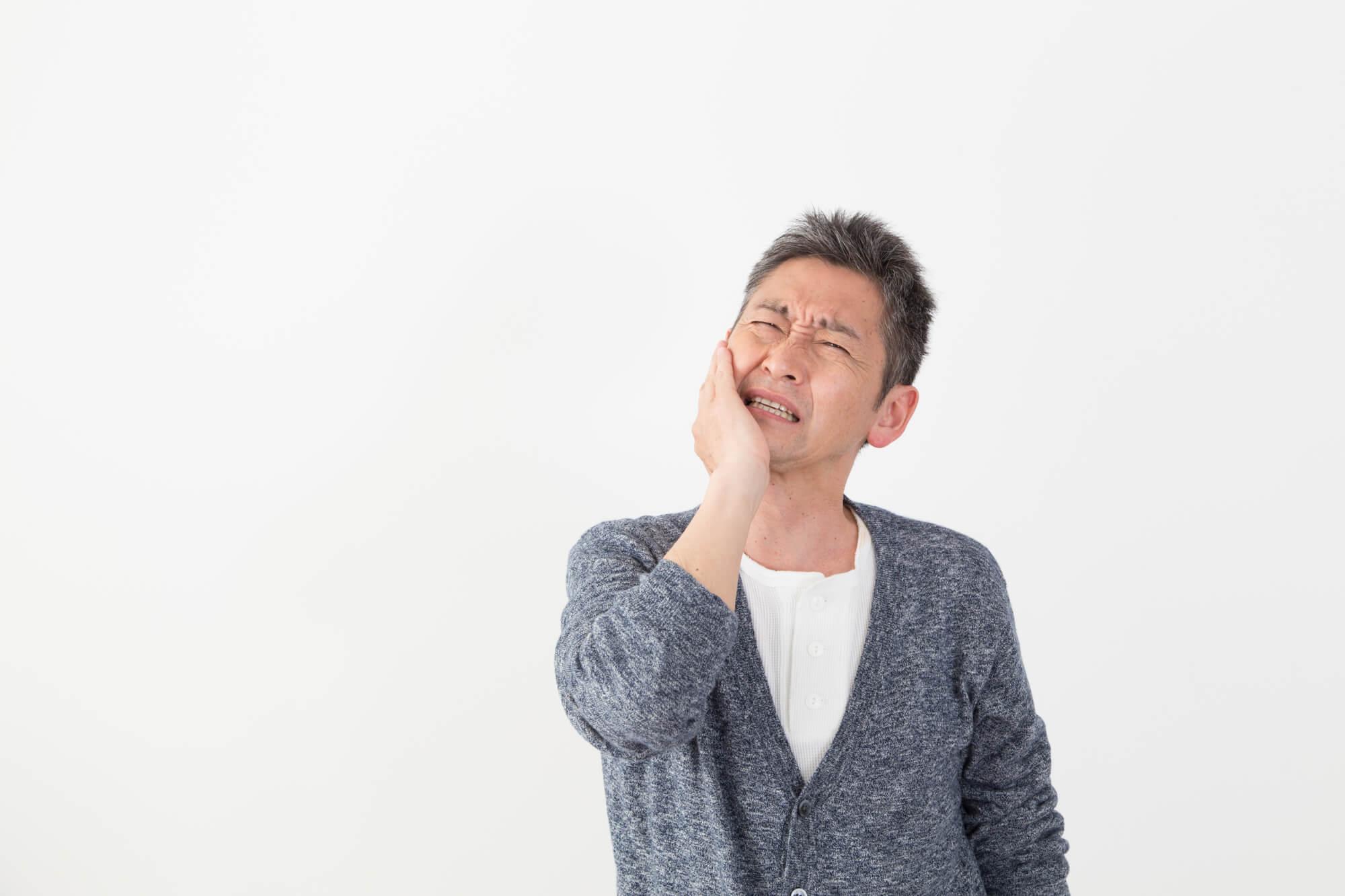 歯痛な男性
